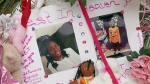 Photos adorn a large memorial to Trinity Love Jones, the 9-year-old girl whose body was found in a duffel bag along a suburban Los Angeles equestrian trail, in Hacienda Heights, Calif., Monday, March 11, 2019. (AP Photo/Reed Saxon)