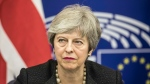 Britain's Prime Minister Theresa May, speaks during a media conference after a meeting with European Commission President Jean-Claude Juncker at the European Parliament in Strasbourg, eastern France, Monday, March 11, 2019. (AP Photo/Jean-Francois Badias)