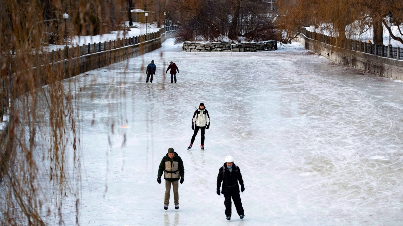 People skate at Paterson Creek on the Rideau Canal Skateway on its opening day, in Ottawa on Sunday, Dec. 30, 2018. THE CANADIAN PRESS/Justin Tang