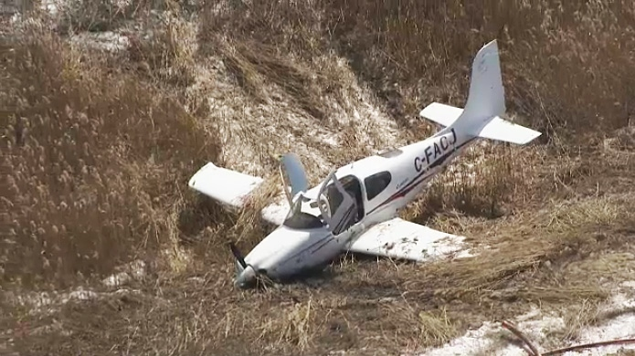 Aerial footage of the crash shows a small aircraft lying in a ditch just north of Buttonville Airport on March 12, 2019.