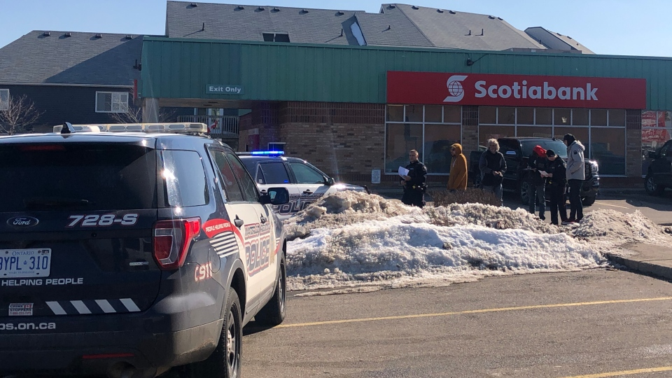 Police cruisers outside of a Scotiabank branch in Cambridge. (Leighanne Evans / CTV Kitchener)