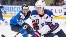 United States' Quinn Hughes (7) fights for control of the puck with Finland's Samuli Vainionpaa (12) during third period IIHF world junior hockey action in Victoria, Monday, Dec. 31, 2018. THE CANADIAN PRESS/Jonathan Hayward