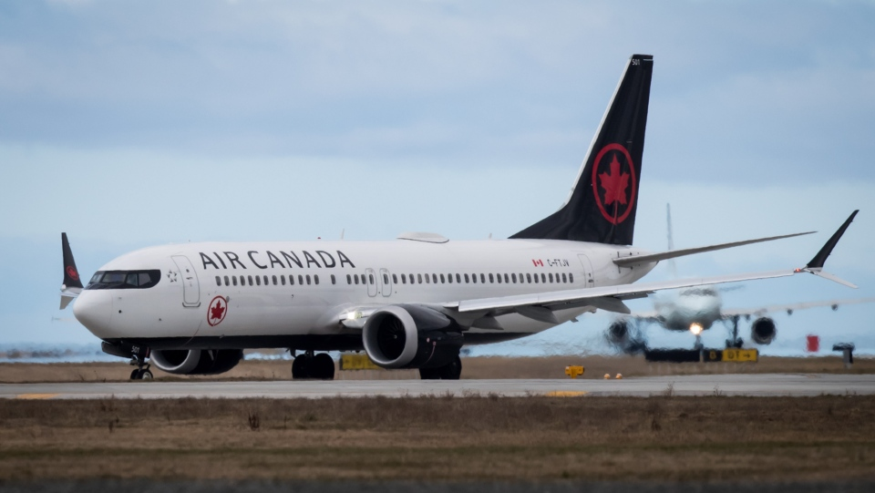 An Air Canada Boeing 737 Max 8 aircraft departing for Calgary taxis to a runway at Vancouver International Airport in Richmond, B.C., on Tuesday, March 12, 2019. (THE CANADIAN PRESS/Darryl Dyck)