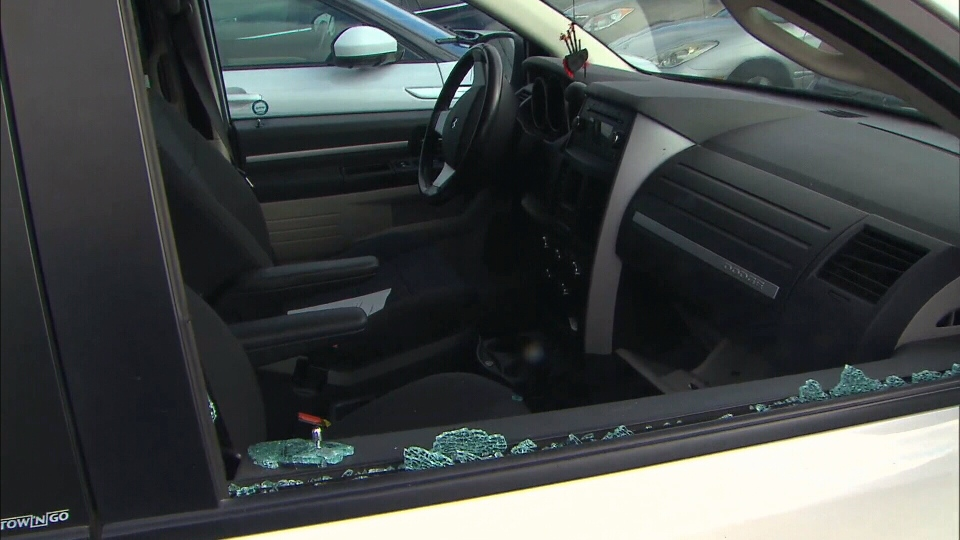 The window of a vehicle sitting at the Hamilton Airport parking lot appears to be smashed.