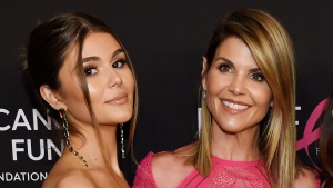 In this Feb. 28, 2019 file photo, actress Lori Loughlin poses with her daughter Olivia Jade Giannulli, left, at the 2019 'An Unforgettable Evening' in Beverly Hills, Calif. (Photo by Chris Pizzello/Invision/AP, File)