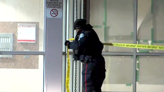 Toronto police tape off the entrance to a building in Pelham Park where the body of a female was found on March 13, 2019.