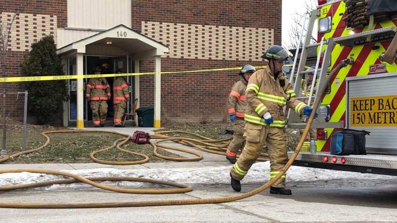 Fire crews work at the scene of an apartment blaze in south London, Ont. on Wednesday, March 13, 2019. (Adrienne South / CTV London)