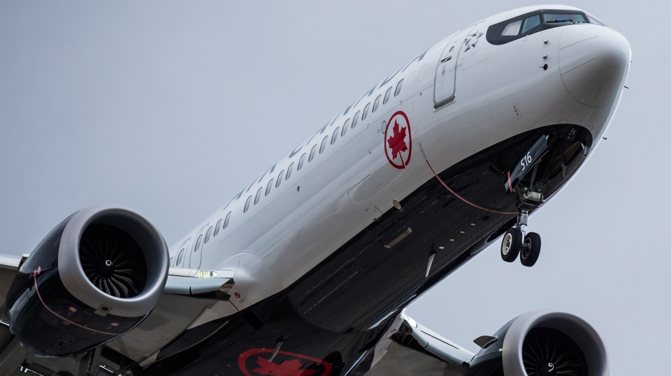 An Air Canada Boeing 737 Max aircraft arriving from Toronto prepares to land at Vancouver International Airport in Richmond, B.C., on March 12, 2019. Boeing's share price has dropped more than 11 per cent -- a loss of more than US$26.6 billion -- since the plane maker's 737 Max 8 fatally crashed Sunday, but Canada's two largest airlines have emerged nearly unscathed. Air Canada and WestJet Airlines Ltd. saw their stocks decline about 3.4 per cent and 2.5 per cent, respectively, since the Ethiopian Airlines disaster that killed all 157 people on board. THE CANADIAN PRESS/Darryl Dyck