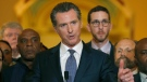 Flanked by lawmakers, Gov. Gavin Newsom discusses his decision to place a moratorium on the death penalty during a news conference at the Capitol, March 13, 2019, in Sacramento, Calif. (AP Photo/Rich Pedroncelli)