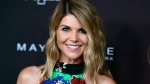 "In this Oct. 4, 2017 photo, actress Lori Loughlin arrives at the 5th annual People Magazine ""Ones To Watch"" party in Los Angeles. (Photo by Richard Shotwell/Invision/AP, File)"