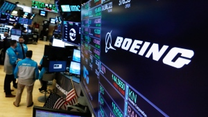 The logo for Boeing appears above its trading post on the floor of the New York Stock Exchange, Wednesday, March 13, 2019. (AP Photo/Richard Drew)