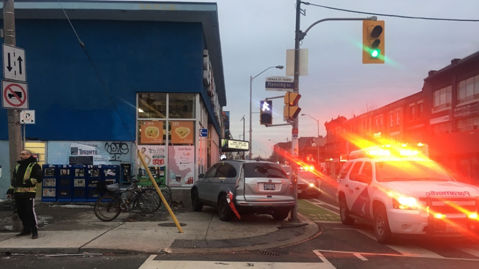 Emergency crews attend the scene of a collision near Bloor Street West and Manning Avenue on March 13, 2019. (CP24 / Kayla Williams)