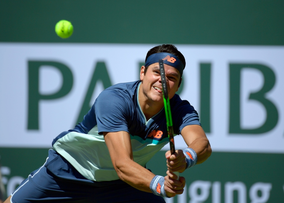 Milos Raonic, of Canada, returns a shot to Jan-Lennard Struff, of Germany, at the BNP Paribas Open tennis tournament Wednesday, March 13, 2019, in Indian Wells, Calif. (AP Photo/Mark J. Terrill)