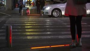 Embedded LED stoplight at a crosswalk in Tel Aviv