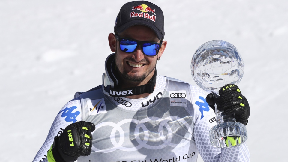 Dominik Paris holds the men's World Cup super G discipline trophy, at the alpine ski World Cup finals, in Soldeu, Andorra, on March 14, 2019. (Alessandro Trovati / AP)