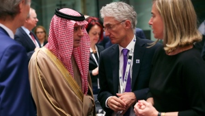 Saudi Arabia's Foreign Minister Adel Al-Jubeir, left, talks to UN Under-Secretary-General for Humanitarian Affairs Mark Lowcock, centre, and European Union foreign policy chief Federica Mogherini, right, during a Syria donors conference at the European Council headquarters in Brussels, Thursday, March 14, 2019. (AP Photo/Francisco Seco)