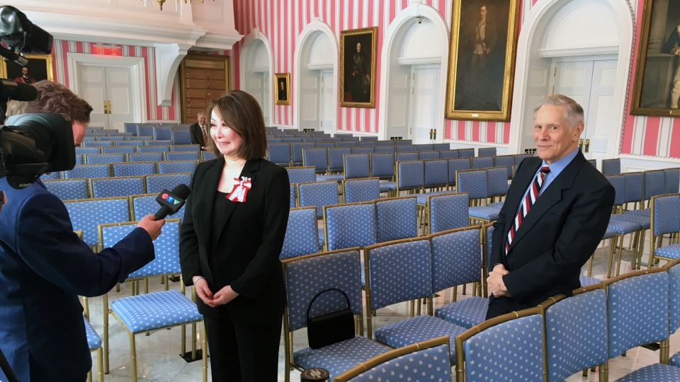 Rob Lurie interviews Mutsumi Takahashi while being observed by Bill Haugland