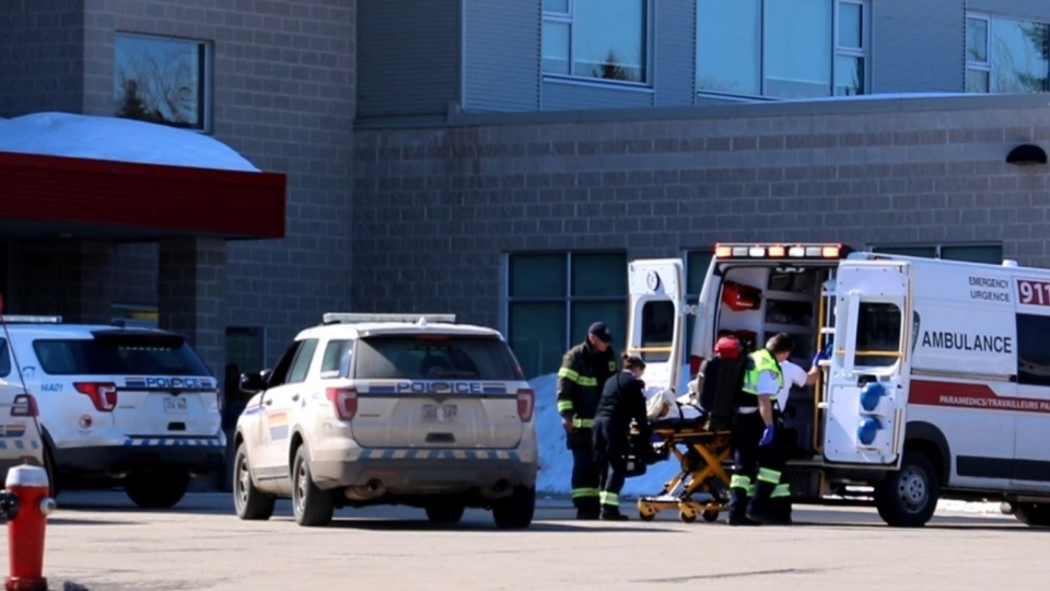 Paramedics take a student from Moncton High School to a waiting ambulance that transported him to hospital. There are unconfirmed reports that one male student stabbed another at lunch time. One male student was believed to have been arrested by police. (COURTESY WADE PERRY)