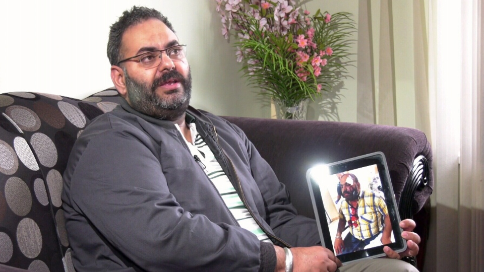 Former taxi driver Mandeep Sandhu speaks to CTV News while holding a photo of himself he was the victim of a brutal road rage attack in 2018.
