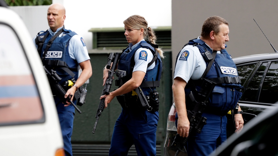 Armed police patrol outside a mosque in central Christchurch, New Zealand, Friday, March 15, 2019.  (AP Photo/Mark Baker)