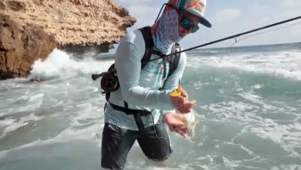 Tim Hepworth displays his catch during his time fly fishing in Oman (supplied)