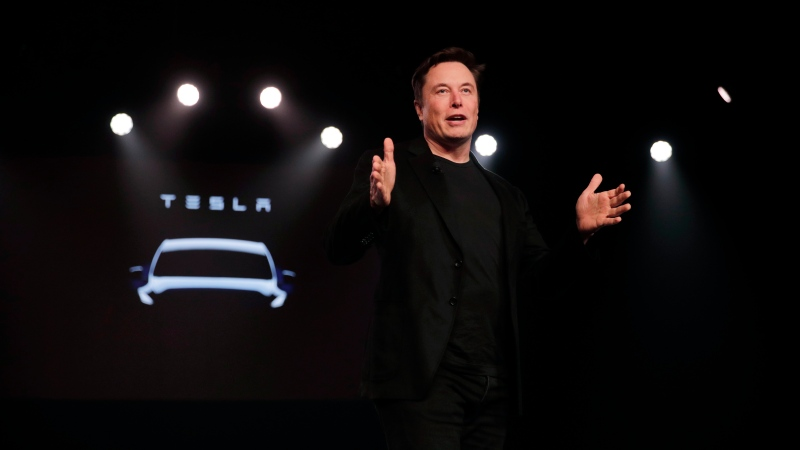Tesla CEO Elon Musk speaks before unveiling the Model Y at Tesla's design studio Thursday, March 14, 2019, in Hawthorne, Calif. (AP Photo/Jae C. Hong)