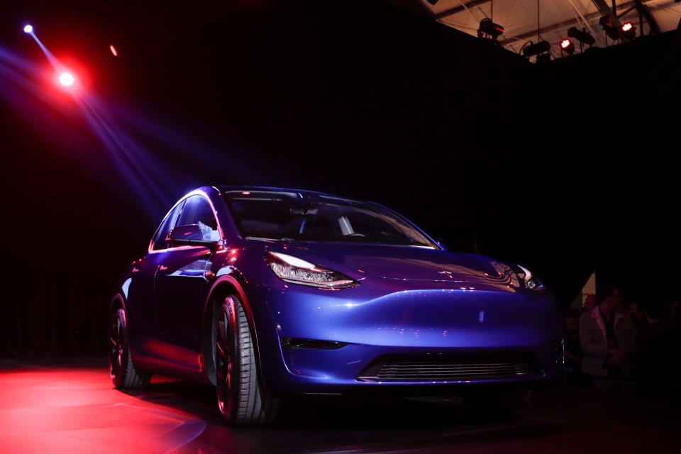 The Tesla Model Y is unveiled at Tesla's design studio Thursday, March 14, 2019, in Hawthorne, Calif. (AP Photo/Jae C. Hong)