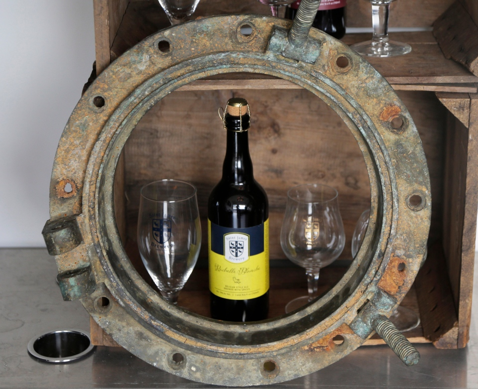 This March 4, 2019, photo shows a porthole recovered from the SS Oregon, a Liverpool-to-New York luxury liner that sank off Fire Island in 1886, at St. James Brewery in Holbrook, N.Y. (AP Photo/Seth Wenig)