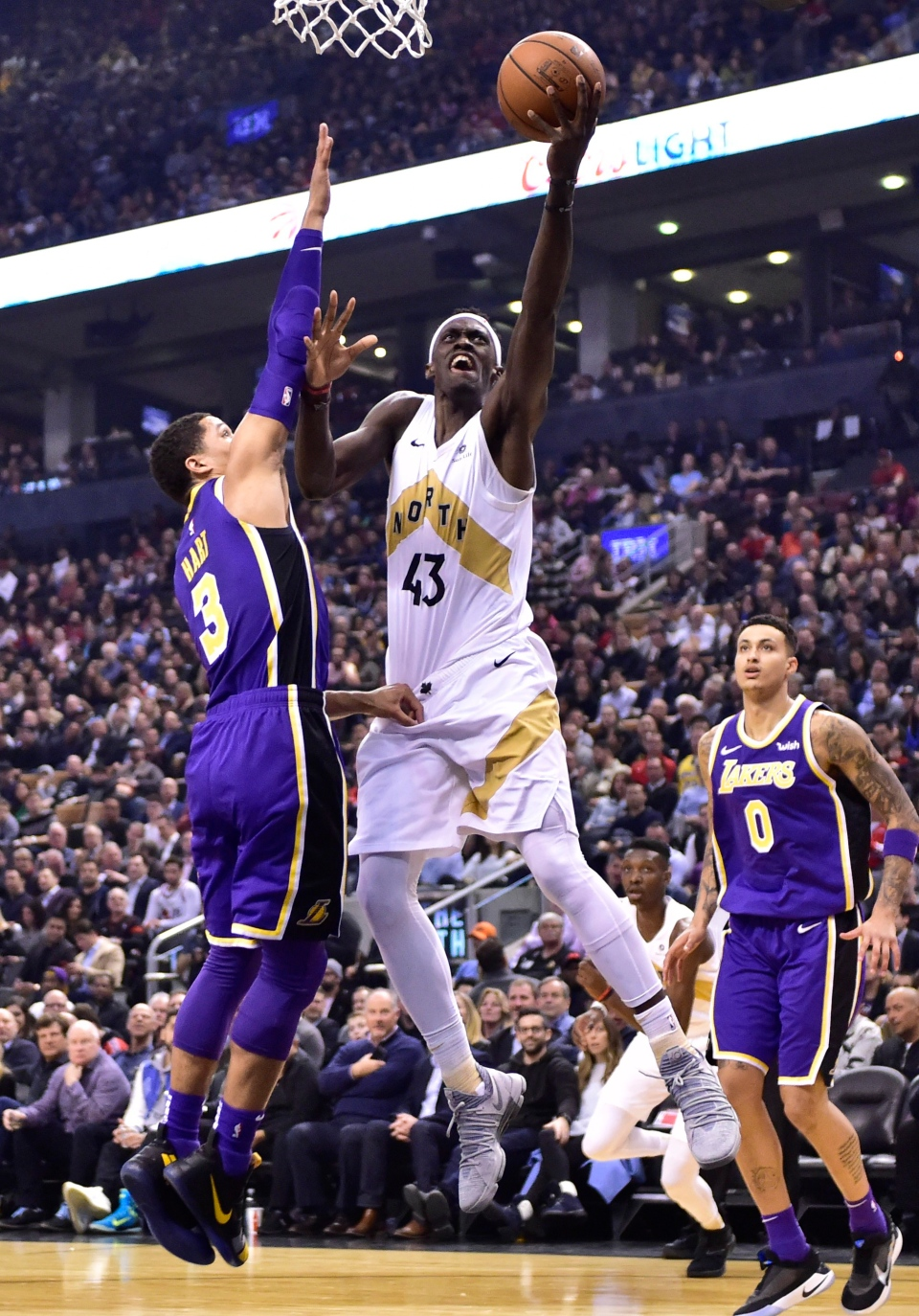 Toronto Raptors forward Pascal Siakam (43) shoots over Los Angeles Lakers guard Josh Hart (3) during first half NBA basketball action in Toronto on Thursday, March 14, 2019. THE CANADIAN PRESS/Frank Gunn