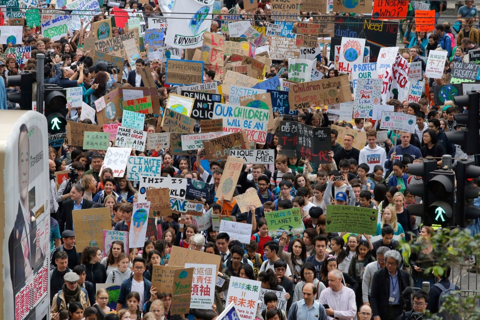 Hundreds of schoolchildren take part in a climate protest in Hong Kong, Friday, March 15, 2019. (AP Photo/Kin Cheung)