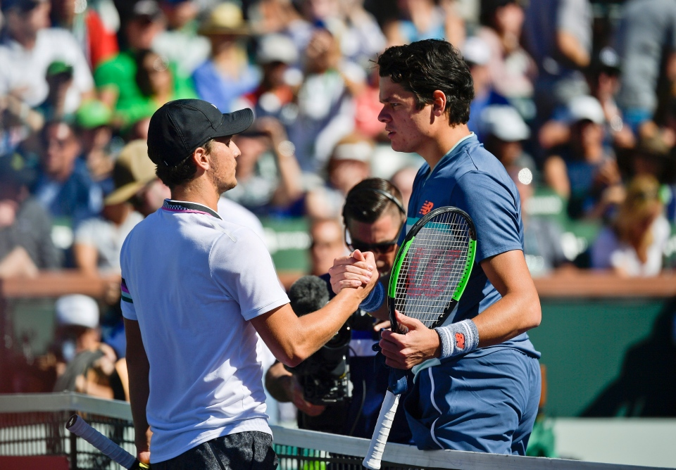 Milos Raonic, right, of Canada, shakes hands with Miomir Kecmanovic, of Serbia, after winning the quarterfinal at the BNP Paribas Open tennis tournament Thursday, March 14, 2019, in Indian Wells, Calif. (AP Photo/Mark J. Terrill)