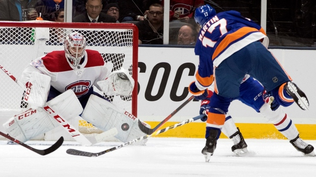 Montreal Canadiens goaltender Carey Price (31) makes the save against New York Islanders left wing Matt Martin (17) during the first period of an NHL hockey game, Thursday, March 14, 2019, in Uniondale, N.Y. (AP Photo/Mary Altaffer)
