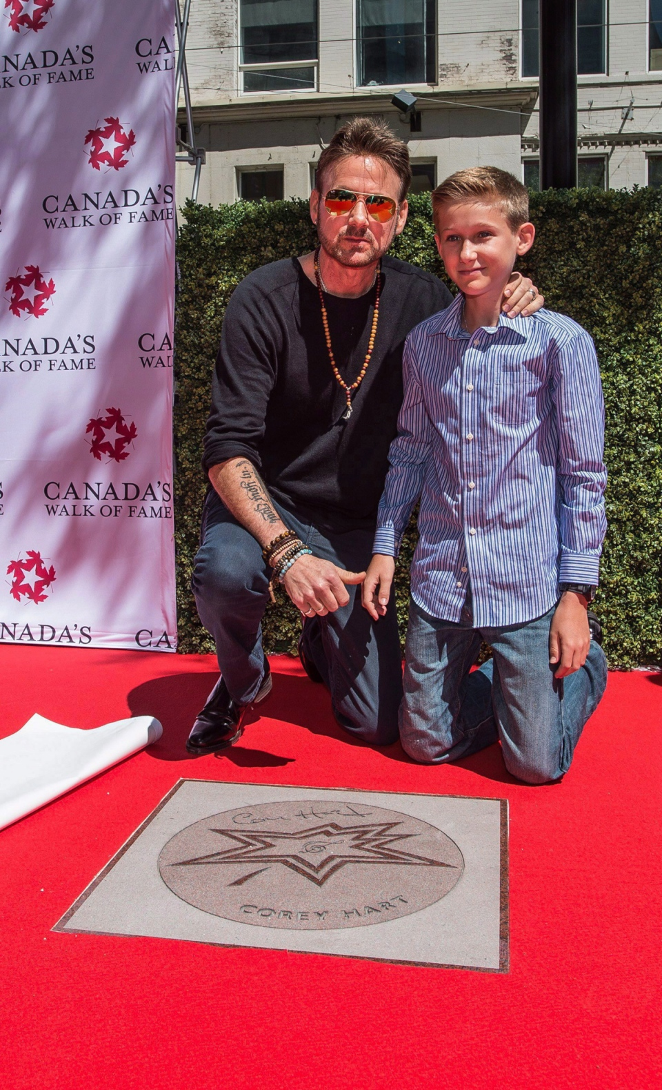 2016 Canada's Walk of Fame inductee Corey Hart poses for a photo with his son Rain in Toronto on June 7, 2017. (Aaron Vincent Elkaim / THE CANADIAN PRESS)