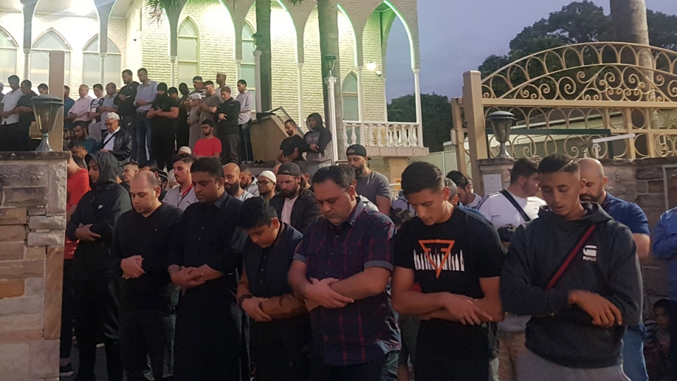Worshippers pray for victims and families of the Christchurch shootings during an evening vigil at the Lakemba Mosque in Wakemba, New South Wales, on March 15, 2019. (Mark Goudkamp via AP)