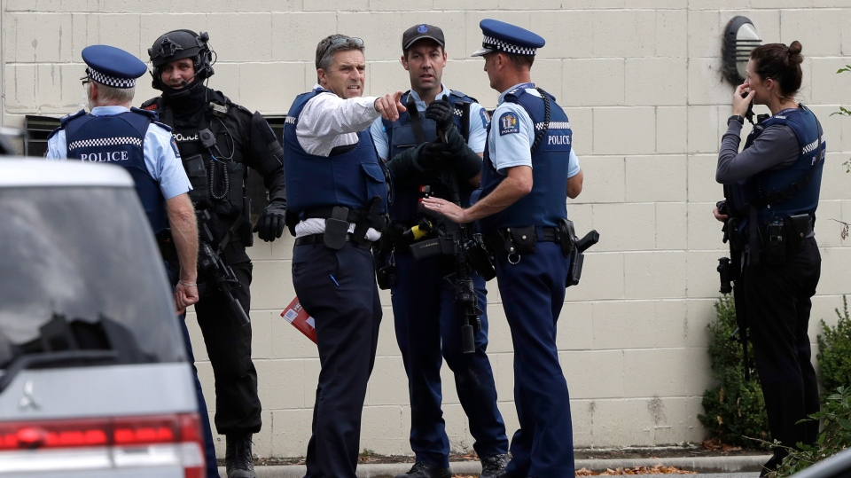 Police stand outside a mosque in central Christchurch, New Zealand, Friday, March 15, 2019. (AP Photo/Mark Baker)