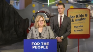 Ontario Education Minister Lisa Thompson stands alongside Parliamentary Assistant, Sam Oosterhoff, as she makes a statement at the Ontario Science Centre in Toronto on Friday, March 15, 2019. THE CANADIAN PRESS/Chris Young