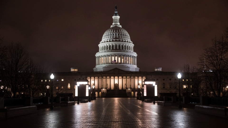 This March 21, 2018 file photo shows the Capitol in Washington before dawn. (AP Photo/J. Scott Applewhite)