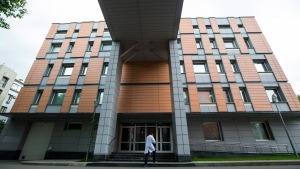 In this Tuesday, May 24, 2016 file photo, an employee walks into the building of the Russia's national drug-testing laboratory in Moscow, Russia. (AP Photo/Alexander Zemlianichenko, File)