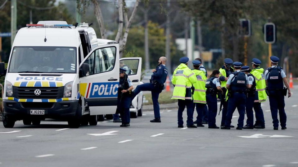 Police gather outside the Linwood mosque, site of one of the mass shootings at two mosques in Christchurch, New Zealand, Saturday, March 16, 2019. (AP / Mark Baker)