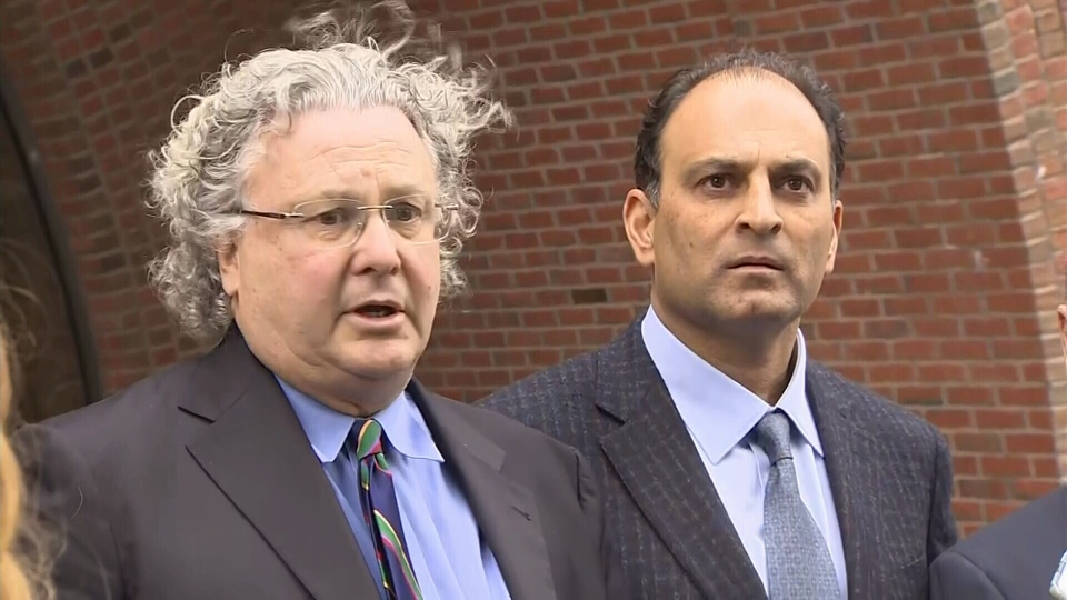 Vancouver businessman David Sidoo (right) appears with one of his lawyers, David Chesnoff, outside court in Boston on March 15, 2019.