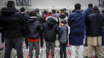Worshippers attend a memorial service at the Al Madinah Islamic Centre in Calgary, Alta., Friday, March 15, 2019, for the victims of the mosque shootings that occurred in New Zealand.THE CANADIAN PRESS/Jeff McIntosh