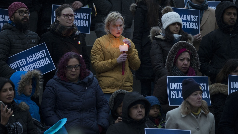 People gather for a vigil in Toronto held for the victims of the New Zealand terror attack on Friday March 15, 2018. Members of Muslim communities across the country offered condolences to the grieving families and spoke out against extremism. (THE CANADIAN PRESS/Chris Young)