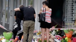 Mourners paying their respects at a makeshift memorial near the Masjid Al Noor mosque in Christchurch, New Zealand, Saturday, March 16, 2019, where one of the two mass shootings occurred. (AP / Mark Baker)