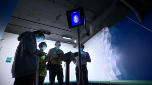 Visitors to 'Immersion Quebec' use tablets to choose and customize an avatar before browsing interactive installations highlighting some of the city's unique attractions. (CTV Montreal)