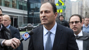 David Sidoo, of Vancouver, Canada, leaves following his federal court hearing Friday, March 15, 2019, in Boston. Sidoo pleaded not guilty to charges as part of a wide-ranging college admissions bribery scandal. (Jonathan Wiggs/The Boston Globe via AP)