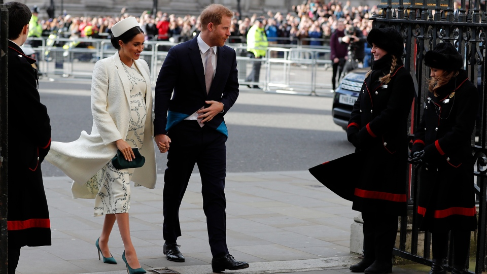 Prince Harry and Meghan Markle, the Duchess of Sussex arrive to attend the Commonwealth Service at Westminster Abbey on Commonwealth Day in London, Monday, March 11, 2019. (AP Photo/Frank Augstein)