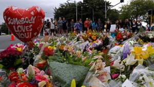 Mourners pay their respects at a makeshift memorial near the Masjid Al Noor mosque in Christchurch, New Zealand, Saturday, March 16, 2019. (AP Photo/Vincent Yu)