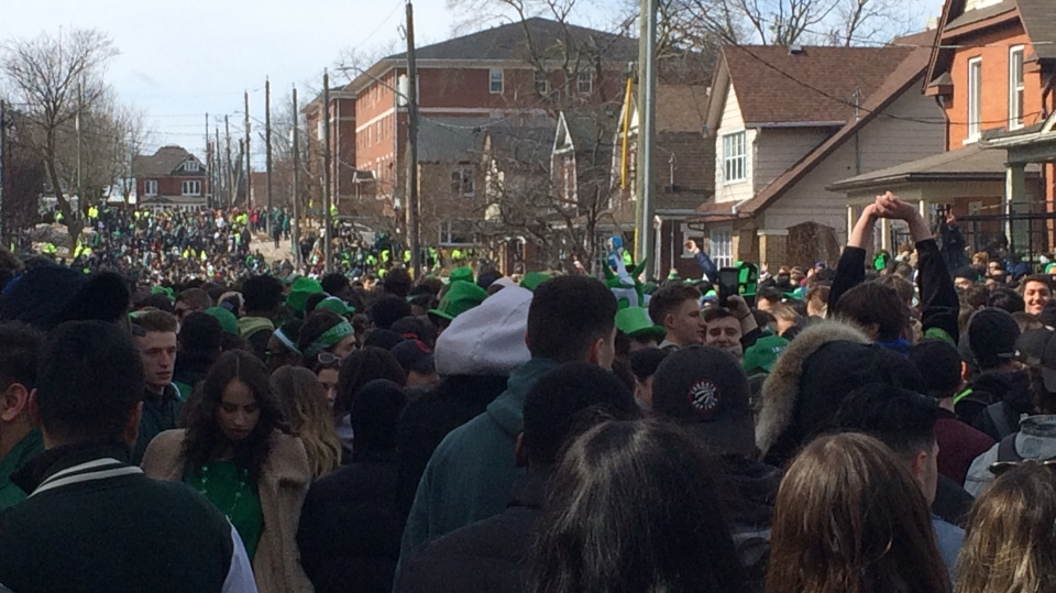 Revellers fill Ezra Avenue for St. Patrick's Day. (Mar. 17, 2019)