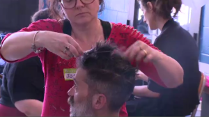 "Josee Denys, a volunteer at the Welcome Hall Mission, cuts a client's hair during the shelter's first-ever ""Dream Day."" (CTV Montreal)"