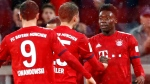 Bayern's Alphonso Davies, right, celebrates after scoring his side's sixth goal during the German Bundesliga soccer match between FC Bayern Munich and 1. FSV Mainz 05 in Munich, Germany, Sunday, March 17, 2019. (AP Photo/Matthias Schrader)